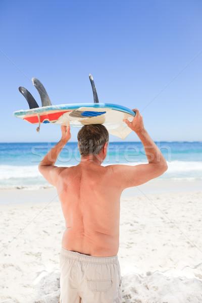 Retired man with his surfboard Stock photo © wavebreak_media