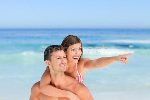Bel homme femme ferroutage plage eau sourire Photo stock © wavebreak_media