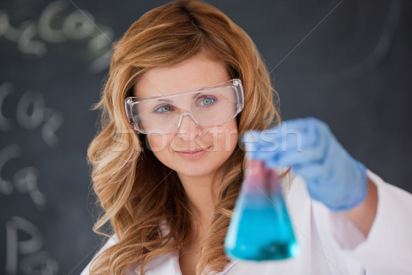 Attractive female scientist carrying out an experiment in a laboratory Stock photo © wavebreak_media