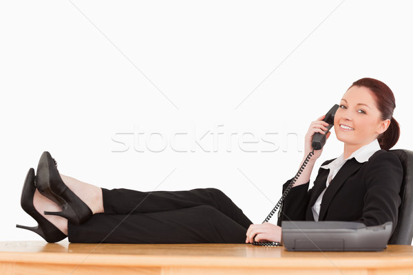Good looking businesswoman on the phone in her office against a white background Stock photo © wavebreak_media