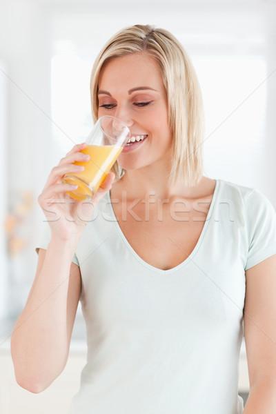 Bájos nő iszik narancslé konyha arc Stock fotó © wavebreak_media