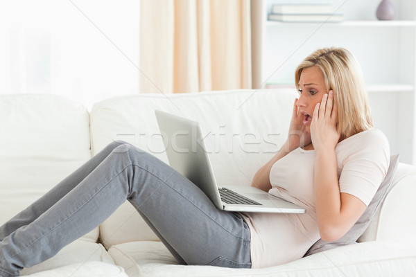 Blonde woman having trouble her laptop in her living room Stock photo © wavebreak_media