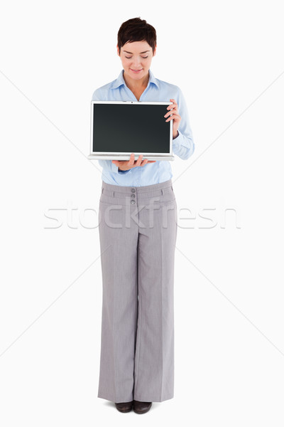 Woman showing a notebook while looking at the screen Stock photo © wavebreak_media