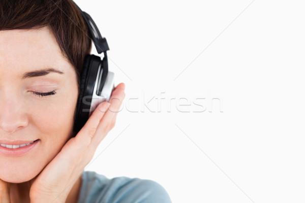 Zachwycony kobieta muzyki biały Zdjęcia stock © wavebreak_media