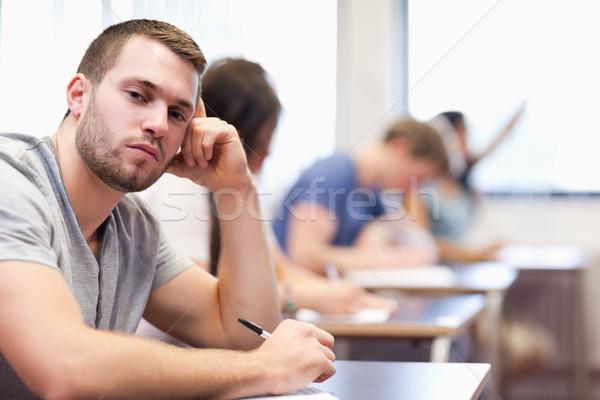Young man posing in a classroom Stock photo © wavebreak_media
