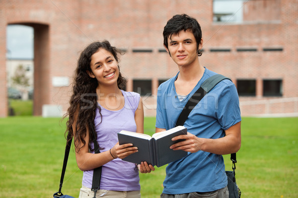 Couple holding a book outside a building Stock photo © wavebreak_media