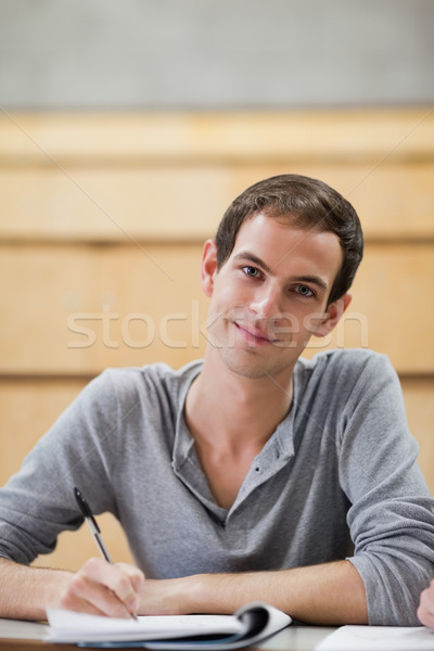 Portrait of a male student holding a pen in an amphitheater Stock photo © wavebreak_media