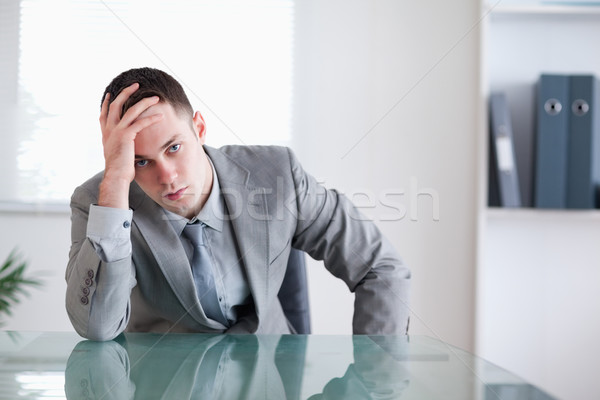 Disappointed businessman sitting behind a table in a conference room Stock photo © wavebreak_media