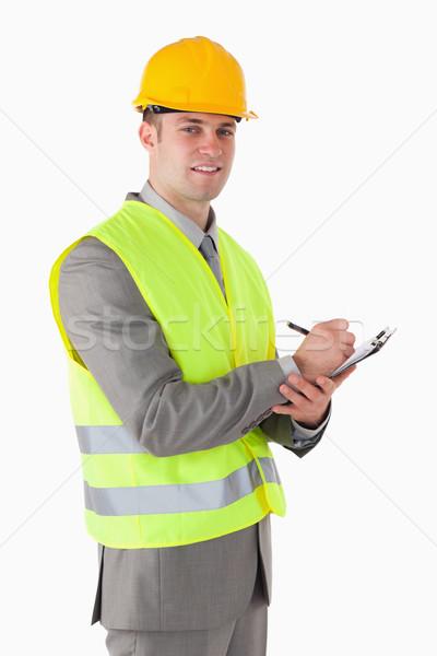 Porträt lächelnd Builder halten Zwischenablage weiß Stock foto © wavebreak_media