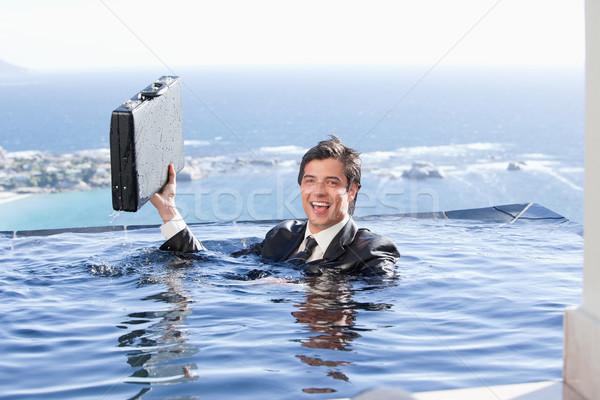 Empresário pasta piscina negócio dinheiro Foto stock © wavebreak_media