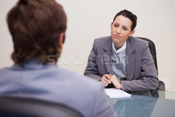 Young businesswoman listening to her business partner Stock photo © wavebreak_media