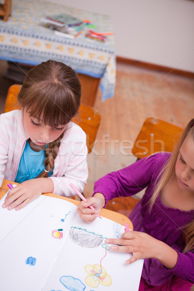 Portrait of a schoolgirls drawing in a classroom Stock photo © wavebreak_media