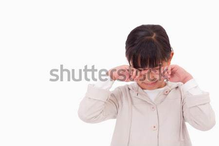 Little girl crying against a white background Stock photo © wavebreak_media