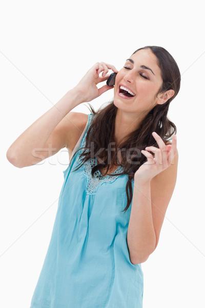 Portré nevet nő készít telefonbeszélgetés fehér Stock fotó © wavebreak_media