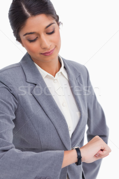 Close up of female entrepreneur looking at her watch against a white background Stock photo © wavebreak_media