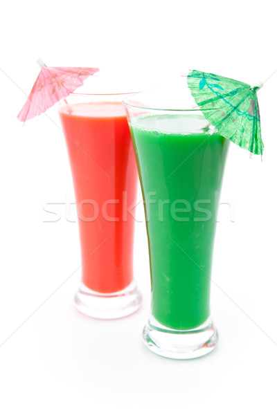 Two full glasses with cocktail umbrella against white background Stock photo © wavebreak_media