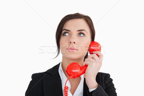 Mulher terno vermelho discar telefone branco Foto stock © wavebreak_media