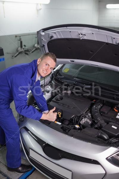 Mekanik araba bakıyor kamera garaj Stok fotoğraf © wavebreak_media