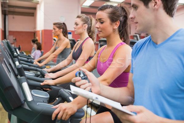 Masculino instrutor cronômetro ginásio mulher esportes Foto stock © wavebreak_media