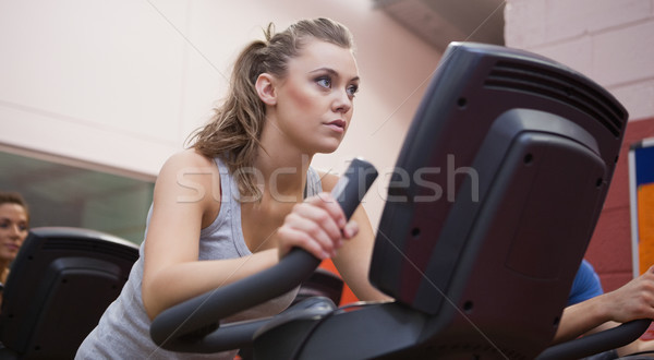 Woman riding in a spinning class in gym Stock photo © wavebreak_media