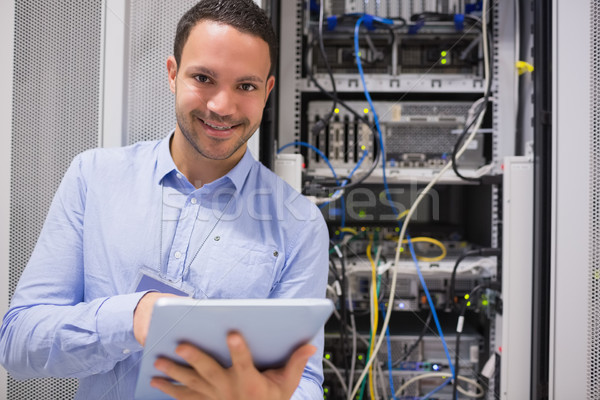 Happy worker with tablet pc in data centre Stock photo © wavebreak_media