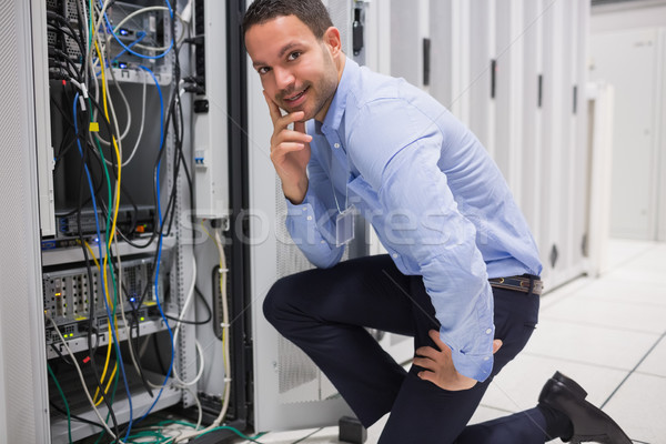 Smiling man checking the servers in data center Stock photo © wavebreak_media