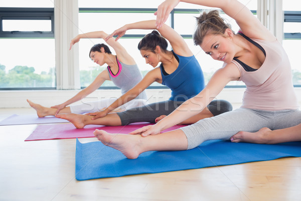 Women stretching on the floor in a gym Stock photo © wavebreak_media