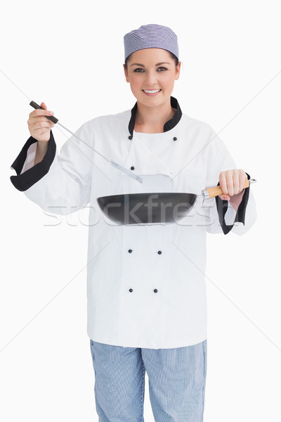 Glad cook cooking with wok and spoon on a white background Stock photo © wavebreak_media