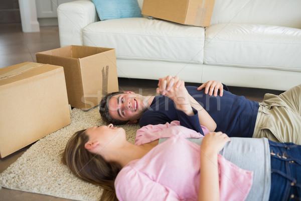 Pár padló költözködő dobozok kéz a kézben ház boldog Stock fotó © wavebreak_media