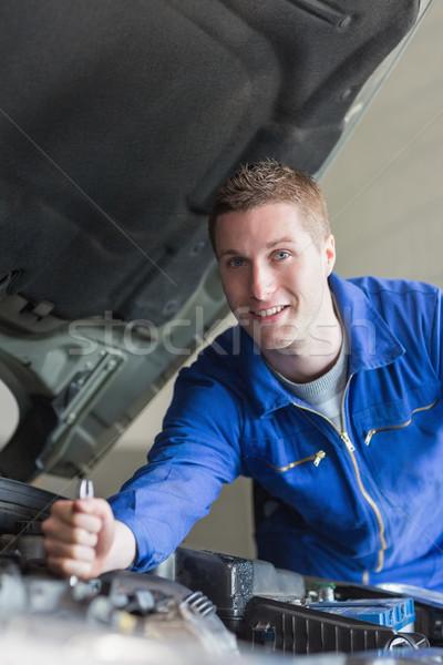Meccanico auto lavoro motore ritratto felice industria Foto d'archivio © wavebreak_media