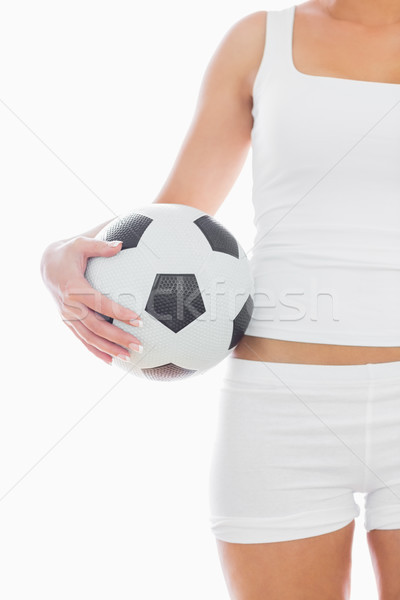Midsection of fit woman in sportswear with football Stock photo © wavebreak_media
