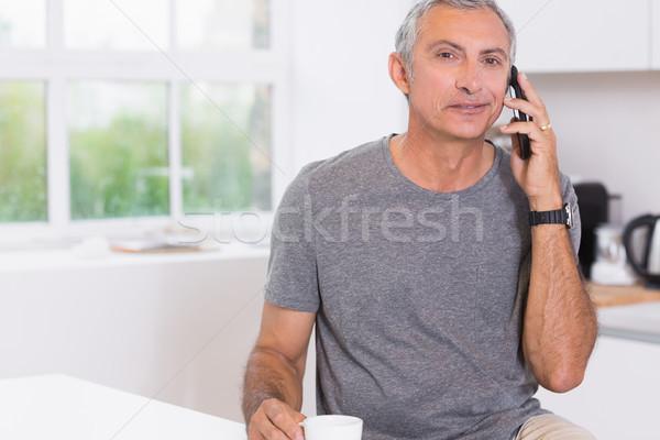 Man drinking while phoning Stock photo © wavebreak_media