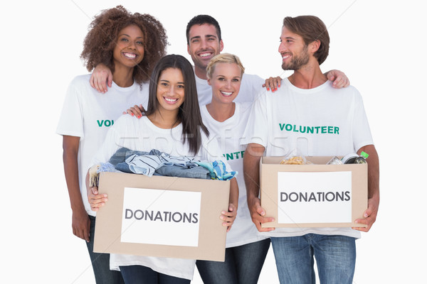 Happy group of volunteers holding clothes donation boxes Stock photo © wavebreak_media