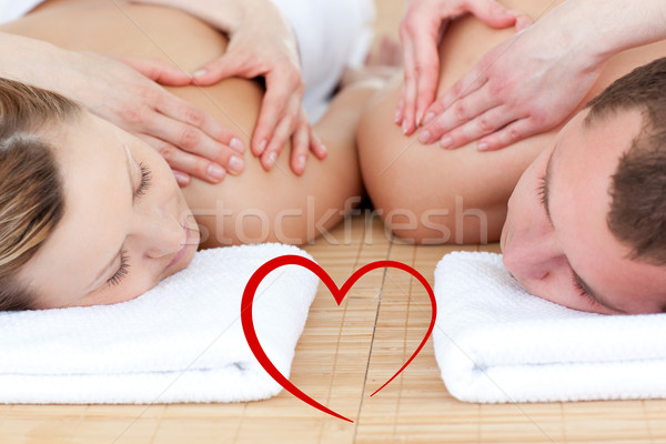 Composite image of young couple receiving a back massage  Stock photo © wavebreak_media