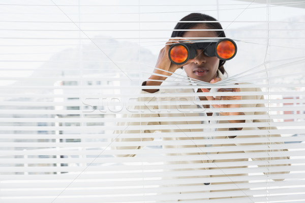 Stock photo: Businessman peeking with binoculars through blinds