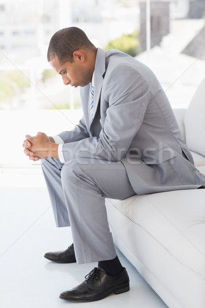 Worried businessman sitting on couch  Stock photo © wavebreak_media