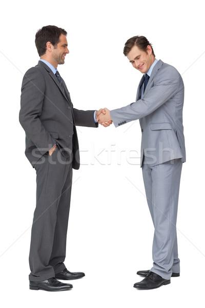 Gelukkig business team handen schudden witte man pak Stockfoto © wavebreak_media