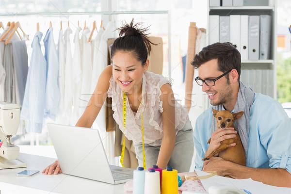 моде используя ноутбук студию мужчины женщины работу Сток-фото © wavebreak_media
