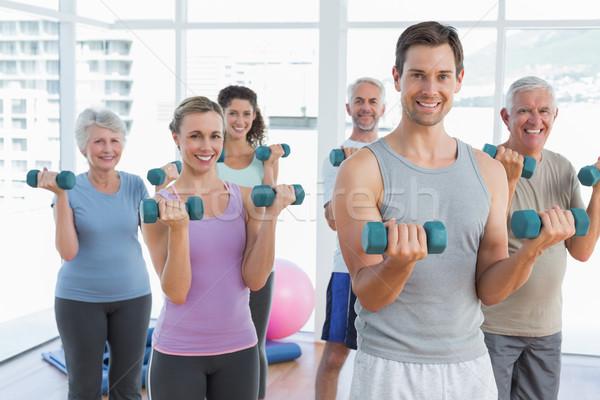 Sınıf egzersiz dambıl spor salonu uygunluk parlak Stok fotoğraf © wavebreak_media