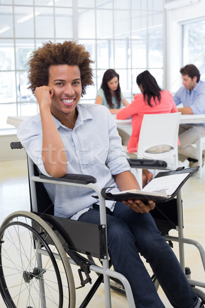 Affaires fauteuil roulant planificateur souriant caméra Photo stock © wavebreak_media