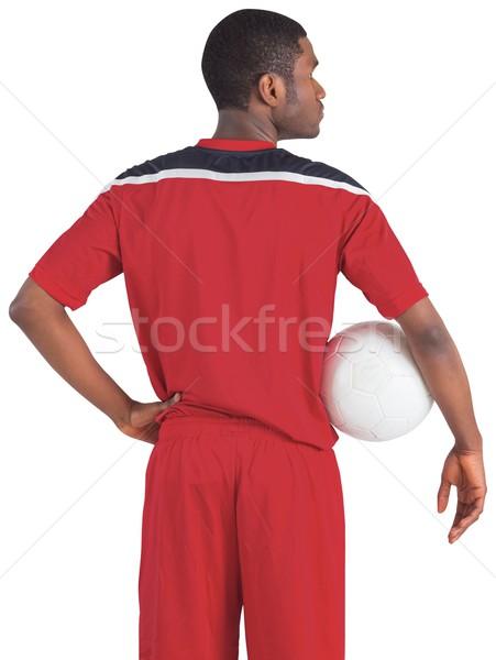 Handsome football player in red jersey Stock photo © wavebreak_media
