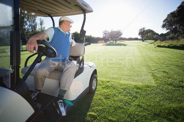 Golfer driving his golf buggy in reverse Stock photo © wavebreak_media