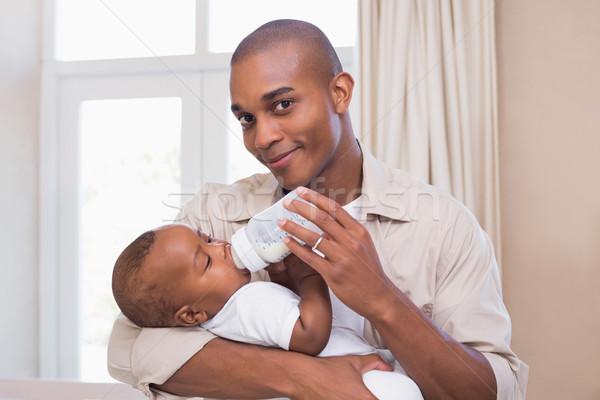Boldog apa etetés baba fiú üveg Stock fotó © wavebreak_media