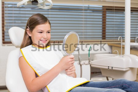 Little girl sitting in dentists chair wearing protective glasses Stock photo © wavebreak_media