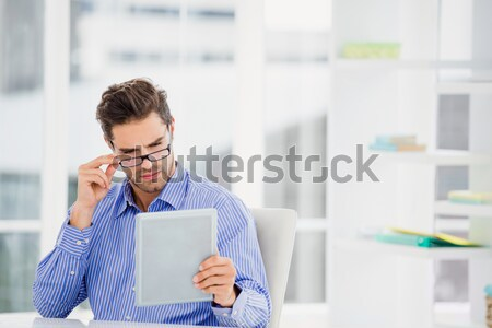 Nerdy casual businessman looking at tablet with shock Stock photo © wavebreak_media