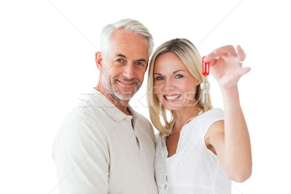 Happy couple showing their new house key Stock photo © wavebreak_media