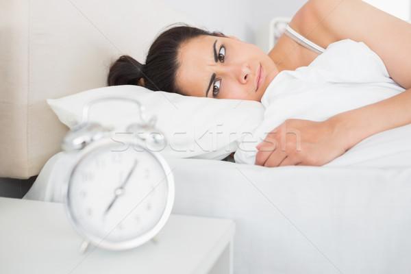 美しい 若い女性 見える 目覚まし時計 表 ホーム ストックフォト © wavebreak_media