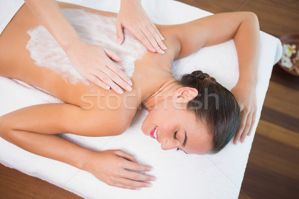 Attractive woman receiving back mask cream at spa center Stock photo © wavebreak_media
