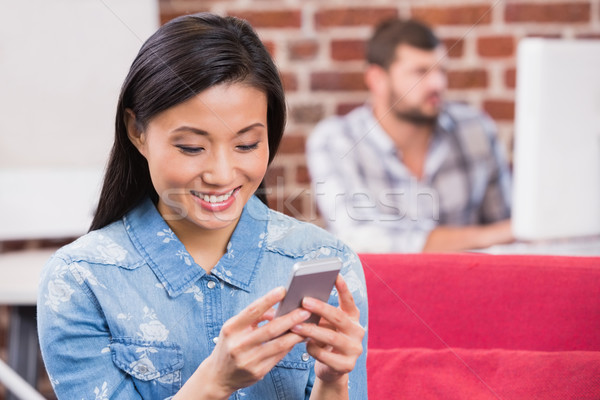 Young casual woman text messaging Stock photo © wavebreak_media