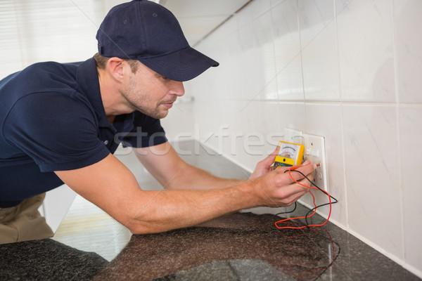 Electrician working at plug socket Stock photo © wavebreak_media